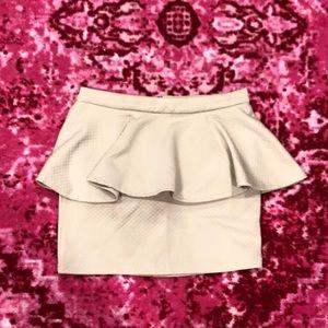 Quilted tan peplum skirt